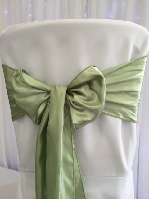 Soft green satin. Hire price £1. Replacement value £4 each.