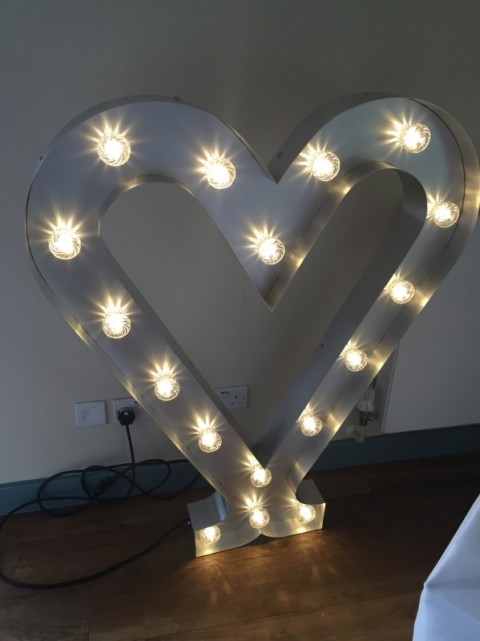 3ft silver illuminated heart. £25 to hire. Replacement value £500.