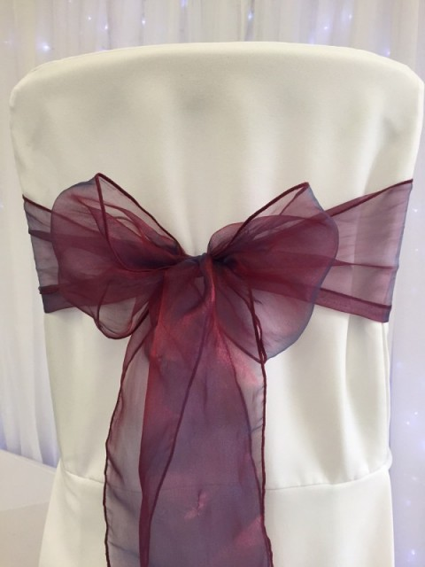 Burgundy blue organza. Hire price £1. Replacement value £3 each.