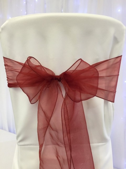 Claret red organza. Hire price £1. Replacement value £3 each