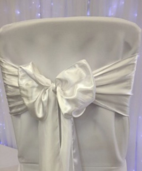 White satin. Hire price £1. Replacement value £4 each.