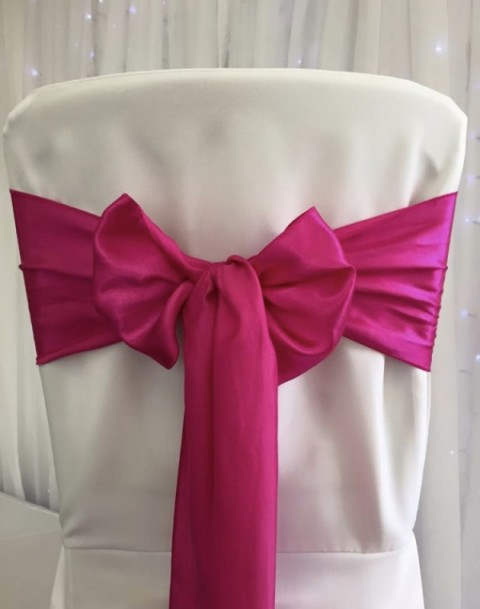 Fuchsia satin. Hire price £1. Replacement value £4 each.