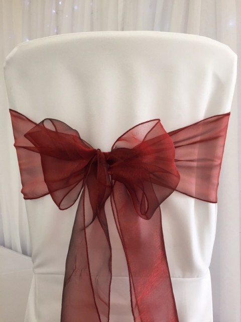 Apple red organza. Hire price £1. Replacement value £3 each
