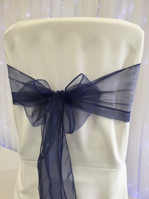 Navy organza sashes. Hire price £1. Replacement value £3 each.