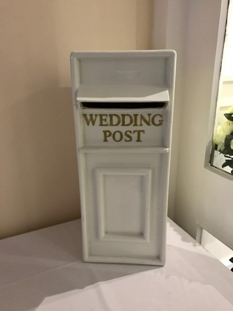White post box with gold lettering