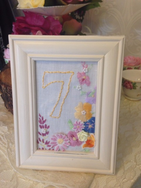Number Top table - 10 embroidered stand - £2.00, replacement £10