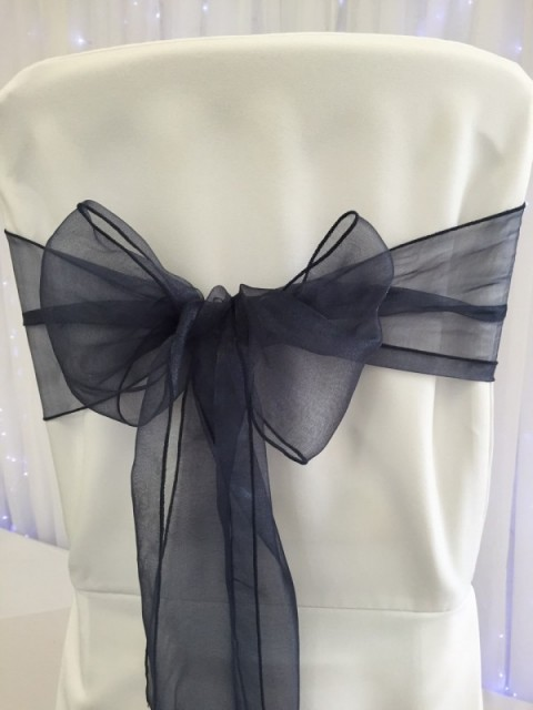 French navy organza. Hire price £1. Replacement value £3 each.