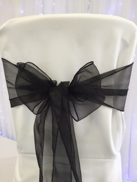 Black organza sashes. Hire price £1. Replacement value £3 each.