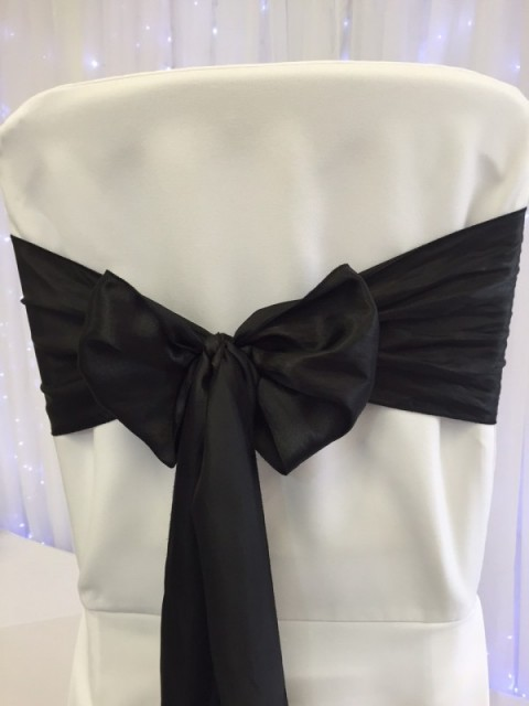 Black satin. Hire price £1. Replacement value £4 each.