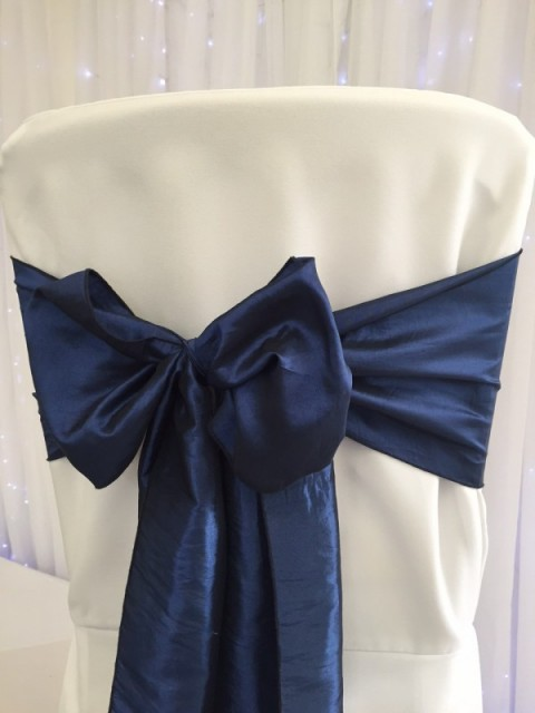 Navy blue taffeta. Hire price £1. Replacement value £5 each.
