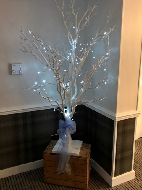 Floor standing white tree for end of aisle or entrance. Lights can also be added.