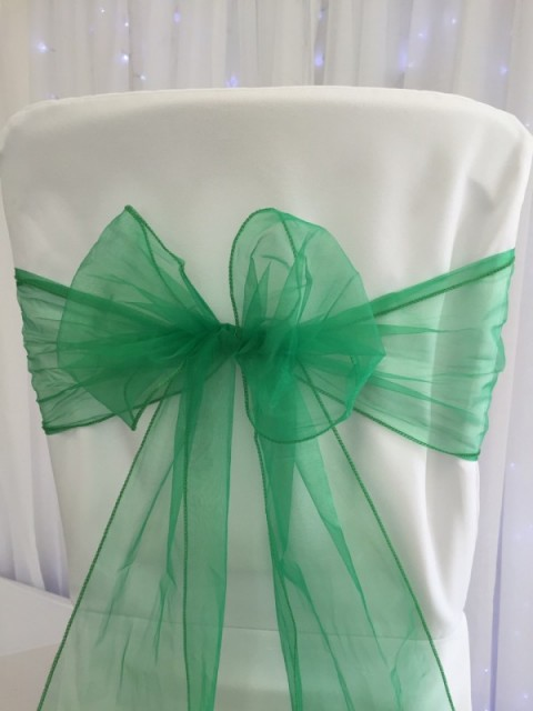 Emerald green organza. Hire price £1. Replacement value £3 each.