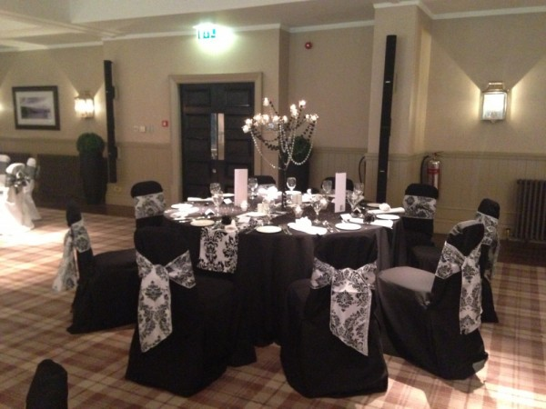 Black hand ironed chair covers at Cameron House