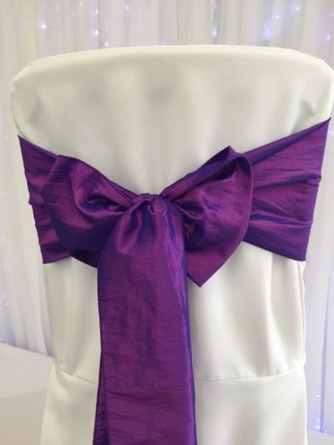 Purple taffeta. Hire price £1. Replacement value £5 each.