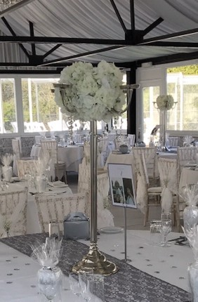 Large silver five arm candelabra, dressed with artificial white hydrangea