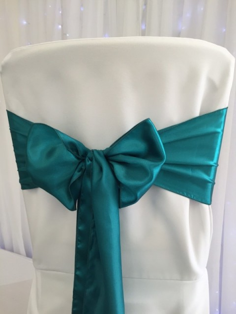 Teal satin. Hire price £1. Replacement value £4 each.
