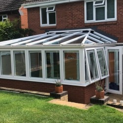 MR AND MRS EVANS APPERLEY A LEAKING  LOW PITCHED GLASS ROOF PRIOR TO FITTING OF A SUPLALITE ROOF