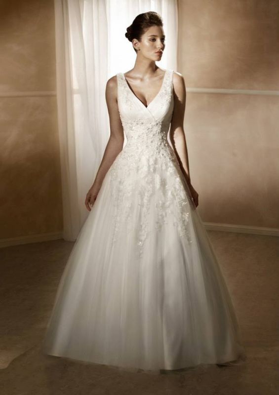 -line, V-neck, Tank style bodice with beaded lace appliqué over satin. Chapel length