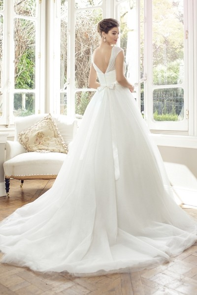 Tulle ball gown, sweetheart neckline with jeweled illusion cap sleeve overlay . Chapel length train