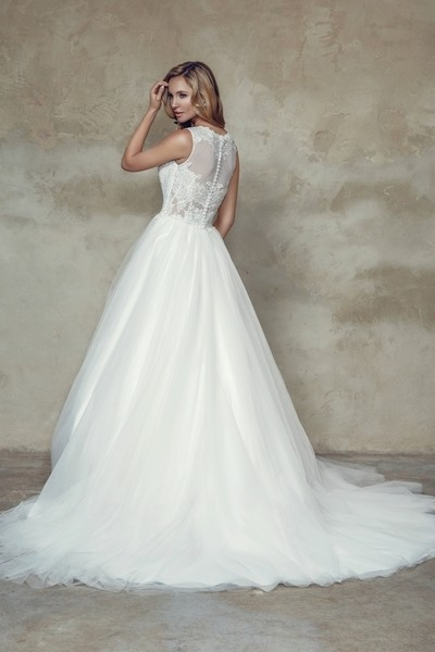 Tulle ball gown with lace neckline and back. chapel length train *optional sleeves available*