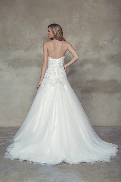 Embroidered satin and tulle A-line. Bodice features richly detailed appliques. Chapel length train.