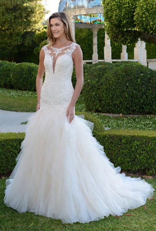 ded/sequined mermaid gown with plunging lace neckline and cascading ruffled skirt