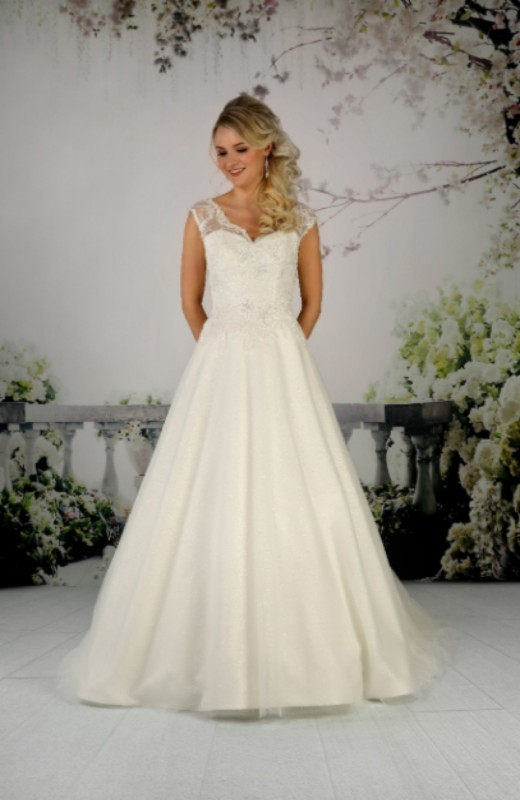 Gown with a shimmering glitter tulle A-line skirt and an intricate lace bodice.
