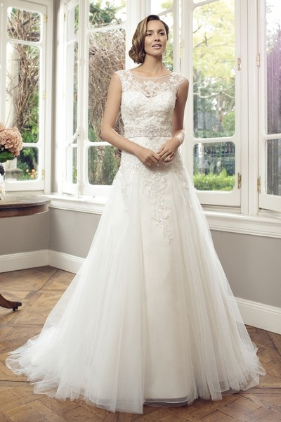 Tulle ball gown with sweetheart neckline, beaded lace overlay. jeweled detail, Chapel length train.