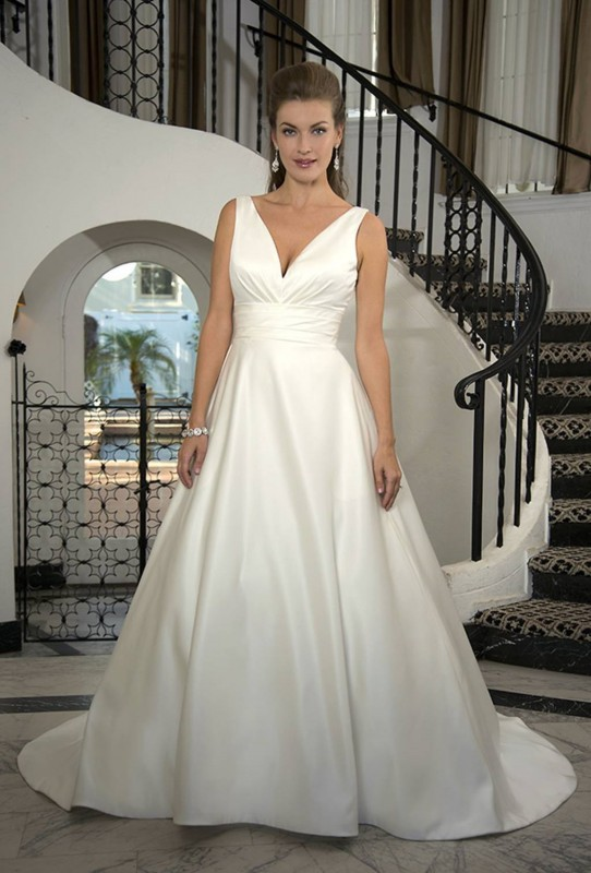 Sleeveless with plunging V neckline & wide pleated waistband