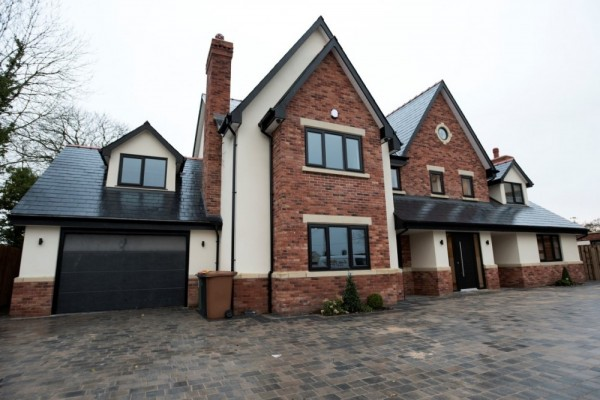Black UPVC windows,Black warmcore Bi-folding doors & Rock composite door