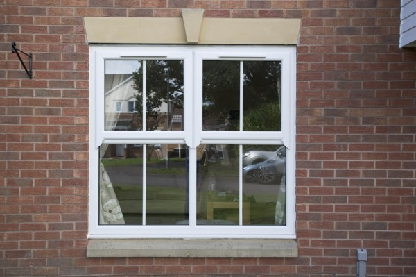 White UPVC Windows with run through sash horns & 25mm georgian bar