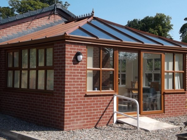 golden oak UPVC Conservatory/Orangery with high specification glass roof