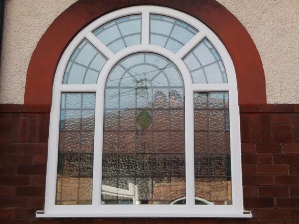 Sunburst Arched White UPVC window with encapsulated units