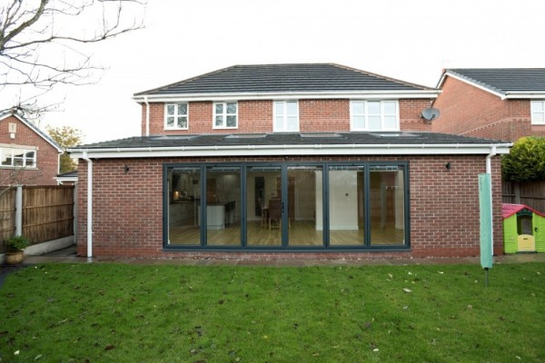 Anthracite grey aluminium bi-folding doors with integral solar blinds