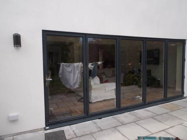 Black On white UPVC Bi-Folding Doors