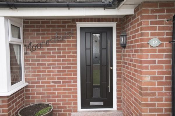 black Rock door with stainless steel bar handle