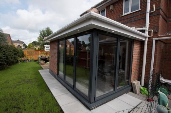 Anthracite grey aluminium corner  bi-folding doors.