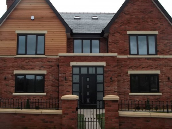 black on white UPVC windows and black composite  door