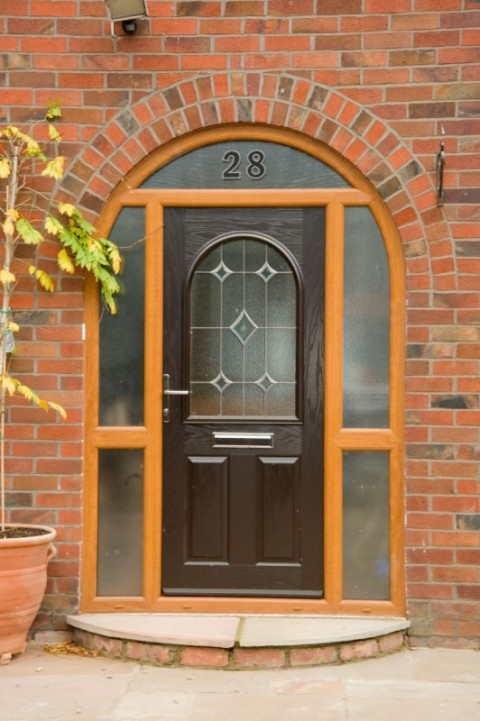 Golden oak arched composite door