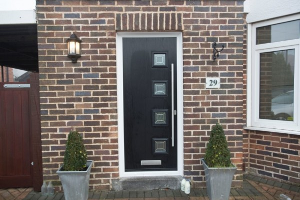 Black composite door with stainless steel bar handle