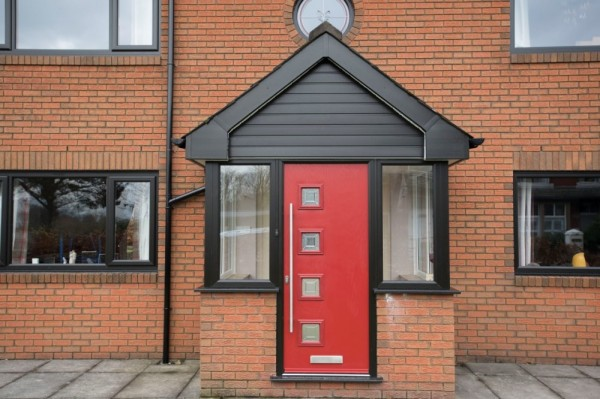 Red composite door with stainless steel bar handle