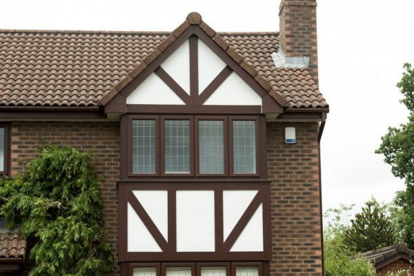 Rosewood fascias,white soffits,rosewood tudor board with white backing boards & brown square rai