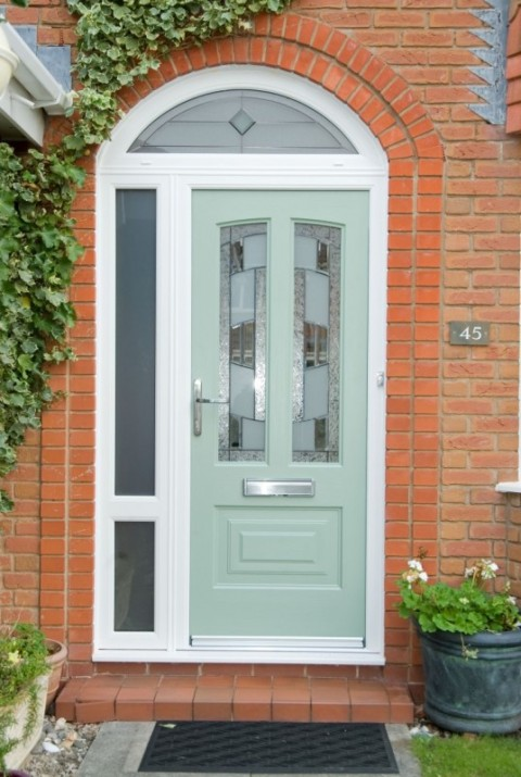 White UPVC Arched frame with chartwell green Rock door