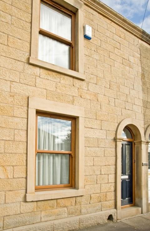 Golden oak UPVC Sliding sash Windows & Composite Door