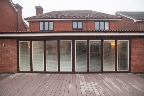Brown out side white in side  aluminium Bi-folding  with integral blinds