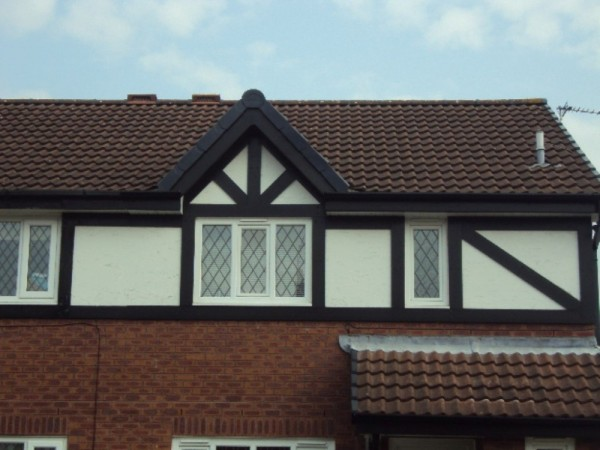 Black UPVC Fascias & White Soffits & Black Tudor Board