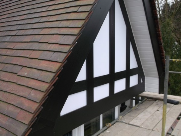 Black UPVC Fascia & white soffits + Black Tudor board and white backing panels