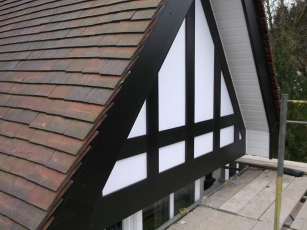 Black UPVC Fascia & white soffits + Black Tudor board and white backing panels