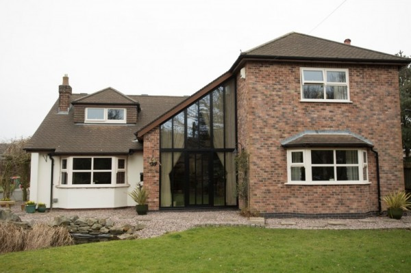 Cream UPVC windows with run through sash horns & Black aluminium entrance frame