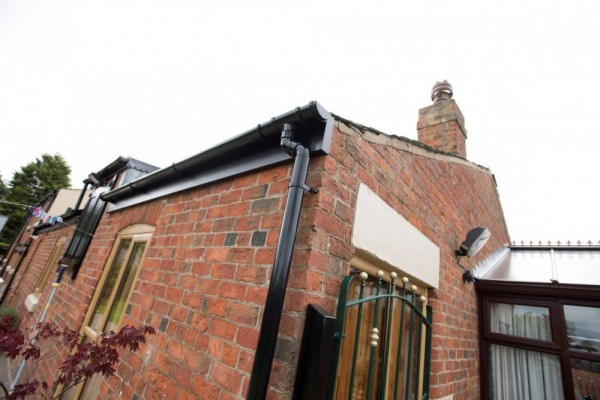 Black fascias & black round rainwater fittings